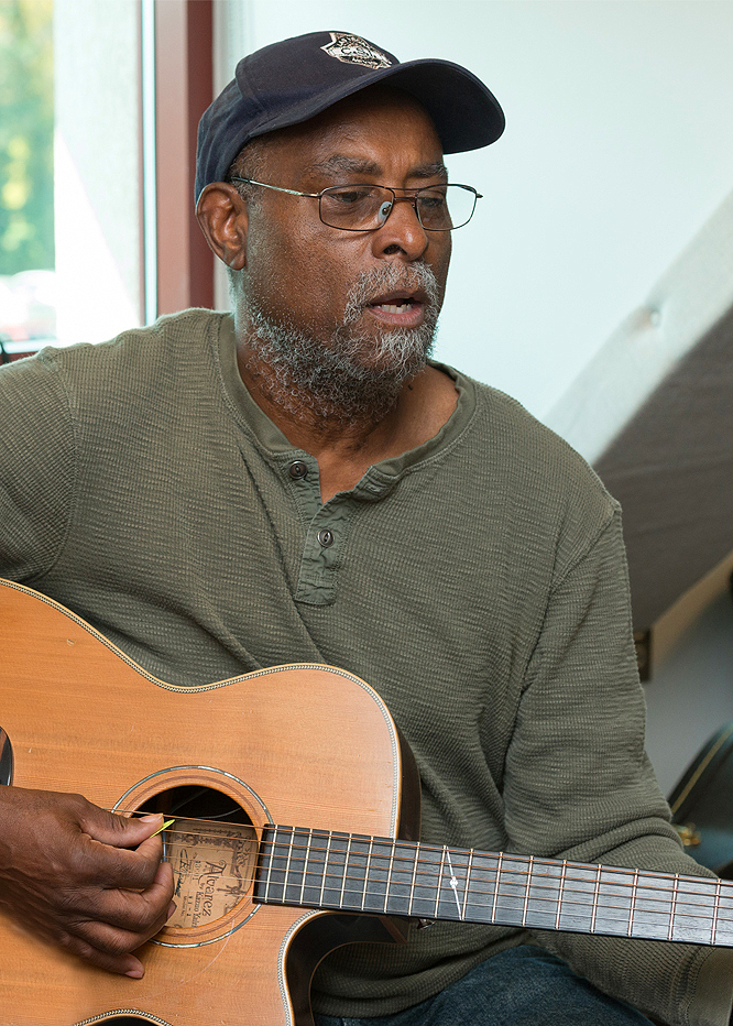 UD Osher Lifelong Learning Institute member playing guitar