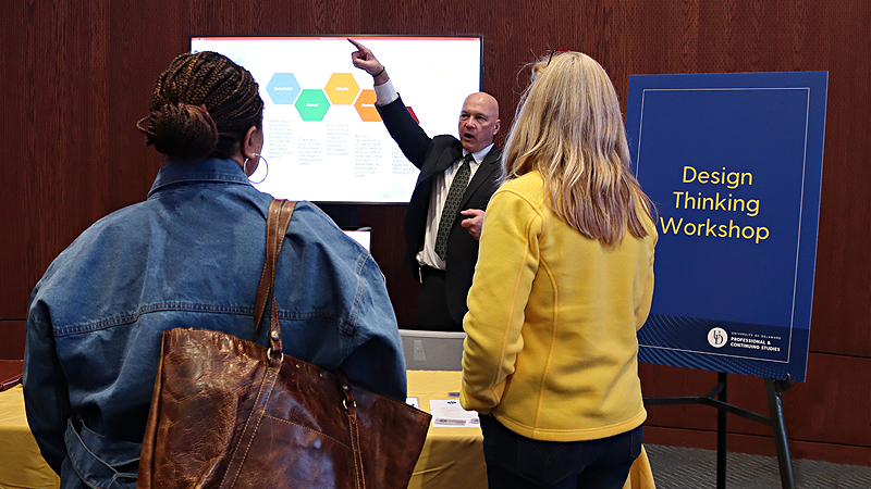 Edward Kashmere points while speaking with prospective students about Design Thinking Workshop