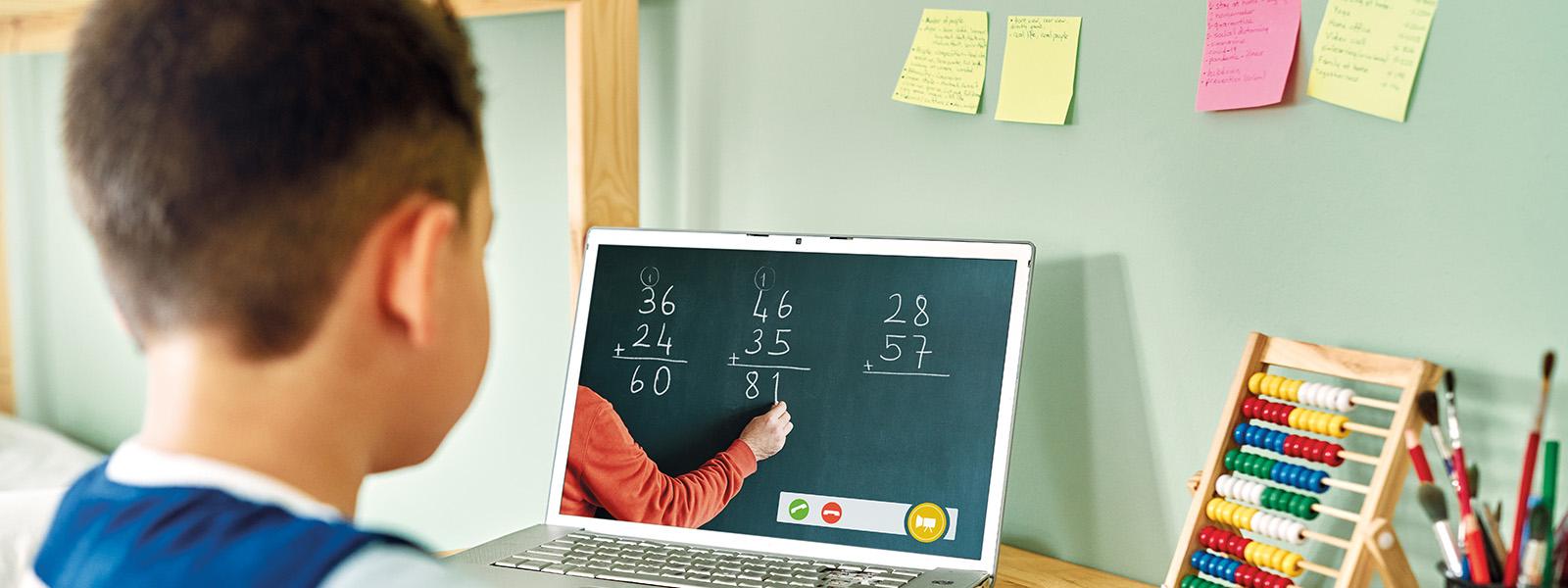 Young boy taking online math class