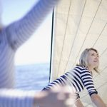 two-women-adjusting-boat-sails