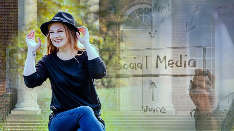 Heather Cox smiling in front of social media whiteboard